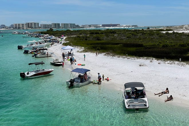 Boaters enjoy the warm temperatures and calm water on U.S. Air Force property next to the Marler Bridge near Destin on Memorial Day.