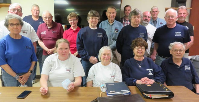 The 2021 Mohican Model A Club officers and Board of Directors held their first in-person meeting this year May 18.  Members had been meeting via Zoom from January through April. Front row, from left, are president Kim Caruso, vice president Sharon Abbott, secretary Mabel Silliman and webmaster Mike Silliman. Second row, from left, are Judy Cousins, Faith Smith, Jane Hicks and Frank D'Amico. Third row, from left, are Ray Cousins, Don Roberts, Sondra Roberts, Bill Kritzler, treasurer Sal Caruso and DeVerne Breed. Back row, from left, are Pat Abbott, Andy Rezsnyak and Elwyn Smith. Absent from photo but participating via Zoom were Ted Neveldine and John and Sharon Voninski. Masks were removed for the photo.