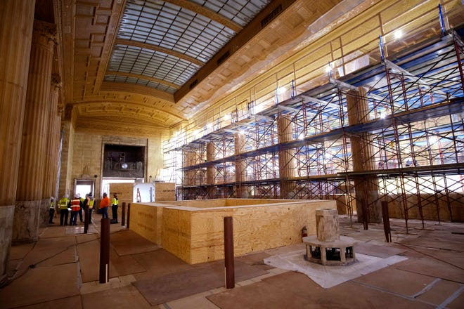The renovation of First National Center includes mural and plaster restoration and cleaning of marble surfaces in building's Great Banking Hall.