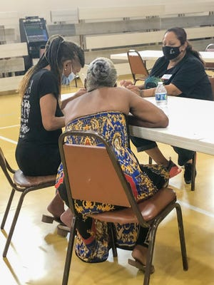 A volunteer walks attendees through the process of applying for Emergency Rental Assistance at Greater Mount Olive Baptist Church. Oklahoma Baptist Southern Convention churches are hosting events for Community Care Partners and Restore Hope Ministries to offer in-person help on Saturdays in June.