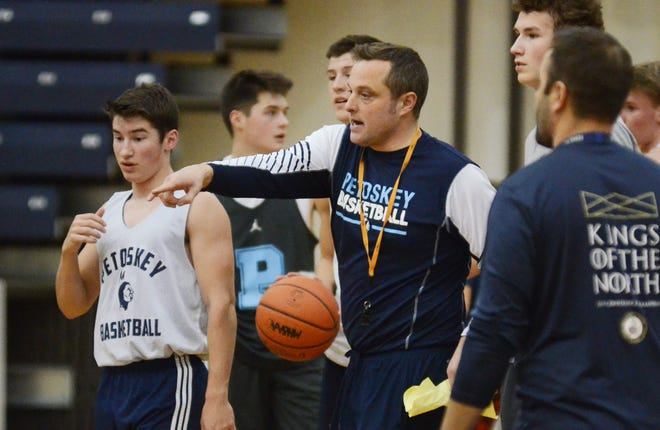 John Flynn (middle) spent the last three years coaching the Petoskey varsity program, though will take the same position at Harbor Springs High School just across the bay.