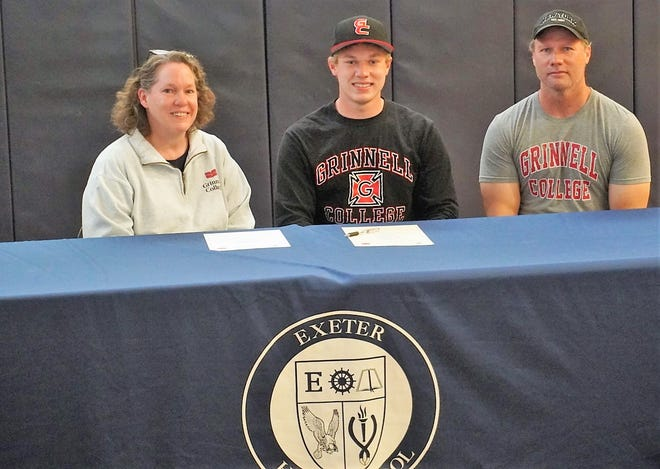 Exeter High School senior Ben Cerrato will play football and baseball next year at Grinnell College, a Division III program in Grinnell, Iowa. Cerrato is seated with his parents Anne and Scott. The Exeter resident plans to study computer science.
