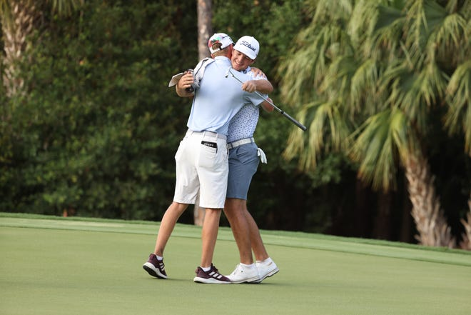 Andrew Kozan hugs his caddie, Justin Burkhamer, after qualifying for his first U.S. Open Monday at the Bear's Club.