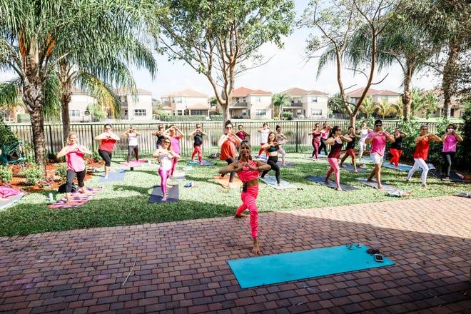 Brie Mazen, the Yoga Mama, teaches a class in her backyard.