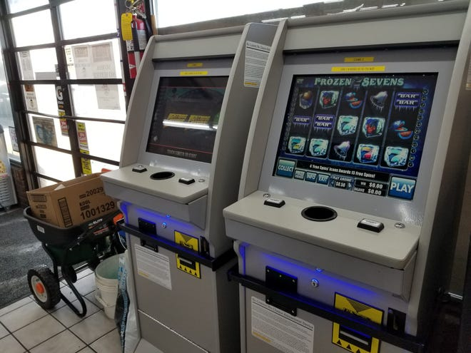 """Two """"no-chance"""" gambling machines await customers in a Columbia convenience store. There have been 26 criminal cases, including seven felony charges, filed over the machines. (Rudi Keller/Missouri Independent)"""