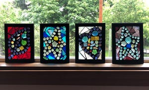 Stained-glass mosaics from Bridgeway House students. The autistic and autism-related youths represented their heroes by a symbolic shape.