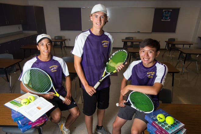 Hononegah tennis players and graduated seniors, from left, Brandon McAllister, Thomas Ptacin, and Brendon Wang pose for a portrait in a classroom at Hononegah High School Tuesday, June 8, 2021, in Rockton. McAllister and Ptacin are top tennis players and co-valedictorians of their class. Wang is a top tennis player and salutatorian of his class.