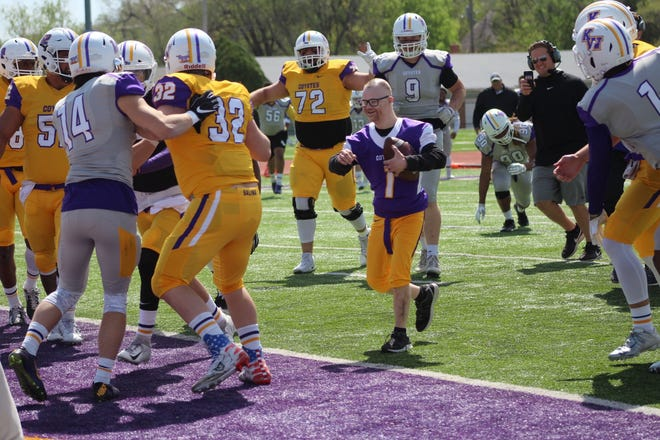 Brandon Baker scores a touchdown during the 2019 spring game at Kansas Wesleyan. Every year since 2014, Kansas Wesleyan kept that tradition alive. Baker died at age 33 Sunday morning.