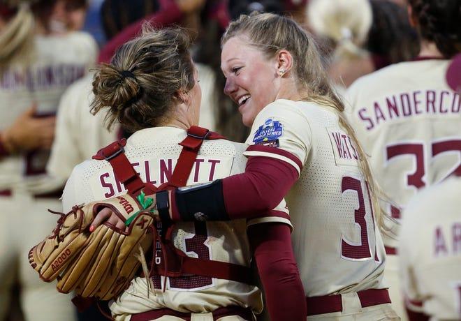 Florida State catcher Anna Shelnutt (13) and Florida State pitcher Danielle Watson (31) celebrate after defeating Alabama during an NCAA Women's College World Series semi finals.