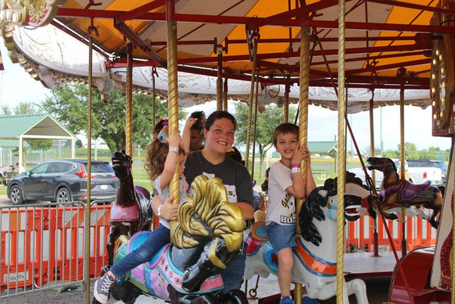 A little rain didn't dampen the spirits of Moo-La Fest attendees over the weekend, with a crowd enjoying a variety of rides, games, live music and more.
