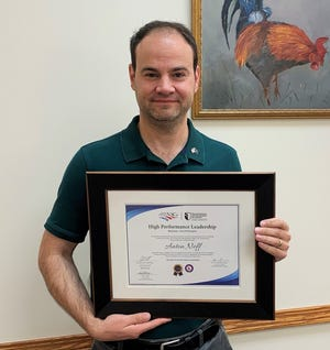 Owen County Councilman Anton Neff proudly displays his certificate for completing the NACo's High Performance Leadership program.