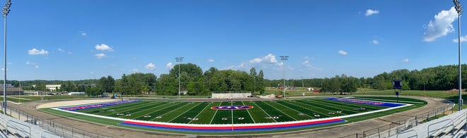 A panoramic look at the progress to the Owen Valley High School football complex and turf is being laid. The field is really starting to take shape with the addition of the red, white and blue numbers, OV symbol and wording in the end zones.