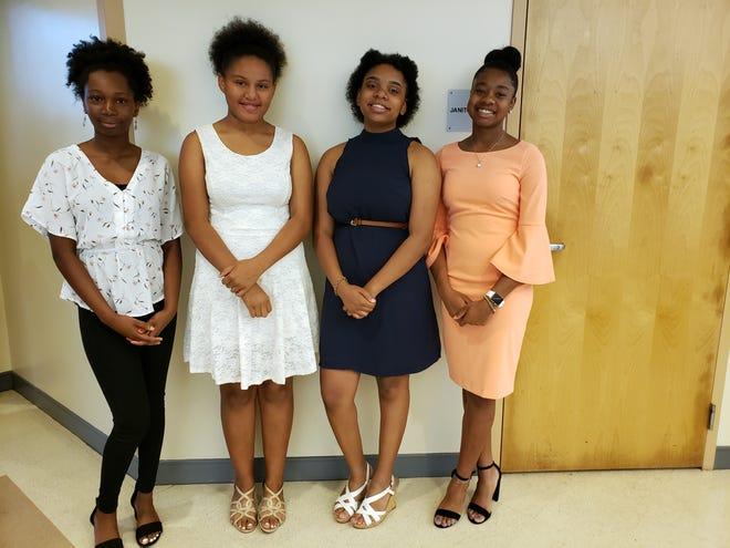 Samara Lee, left, Ariel Samedi, Zaire Kekahuna-Samedi and Jaela Dennis volunteer at the 2020 MLK Breakfast. All four are participants in the Safe Children Coalition Achievers program.