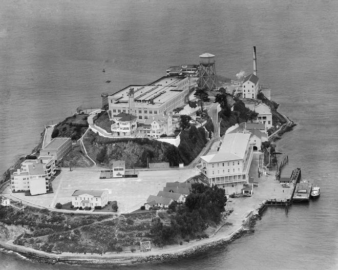 This is an aerial view of Alcatraz Federal Penitentiary in San Francisco Bay, shown June 12, 1962. Three bank robbers escaped the day before by using a crude raft or driftwood. They were never found or heard of again.