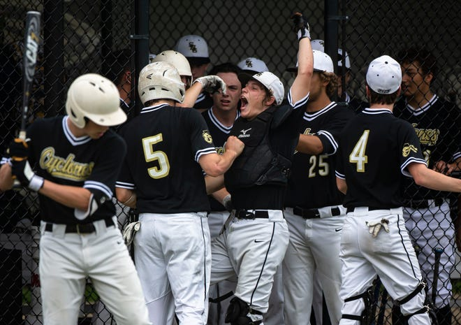 The Sacred Heart-Griffin dugout erupts after Sam Antonacci (5) scored a run against Pleasant Plains in the Class 2A Sectional 6, Regional C finals at Comstock Field on Monday. [Justin L. Fowler/The State Journal-Register]