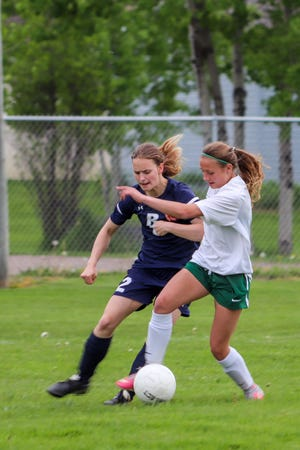 Anna Hildebrand of Sault High, left, competes against Alpena during a game this spring. Hildebrand was named the Sault's MVP this season.