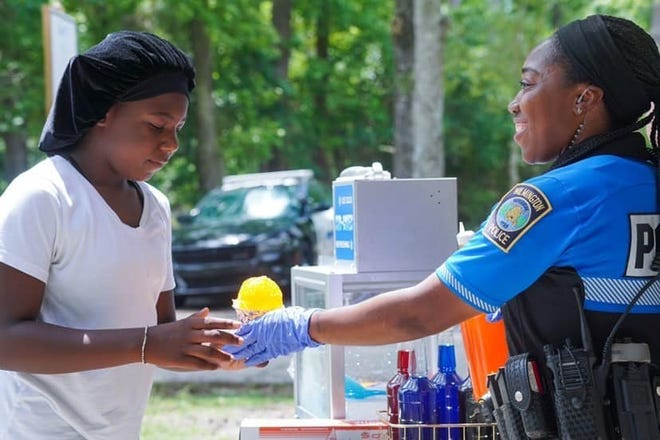 The Wilmington Police Department's Community Engagement Unit handing out snow cones at Maides Park on June 5.