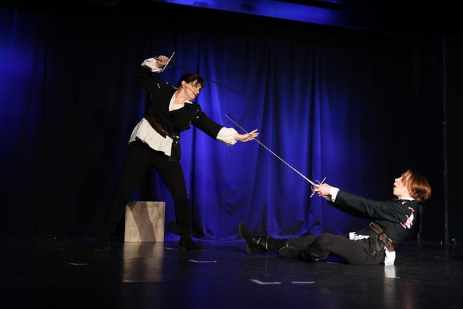 Two actors perform in 'Shakespeare's Reservoir Dogs,' at the Orlando Fringe Festival in Florida. The play received 'Critic's Choice: Best Play Drama.'