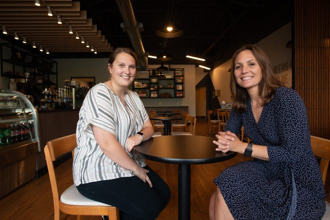 Caitlyn Halsey, left, owner of Dialogue Coffee House, sits with Tara Dimick, right, after chatting about the Topeka Community Foundation's seed-fund program.