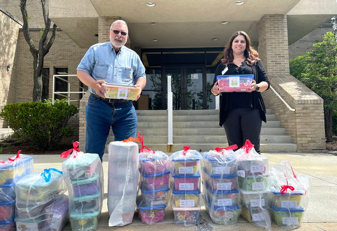 """Allen Pruchnic, on behalf of The Jared Box Project, delivered a variety of boxes created to lift the spirits of children at Chan Soon-Shiong Medical Center at Windber. With him is Kimberly Oleksa, foundations/development administrator at CSSMCW. Boxes filled with the """"gift of play"""" (small gifts, toys, games, crayons, coloring books and fun activities) are given to young patients of all ages. The boxes symbolize the importance of play and are filled with well wishes, hope and love."""