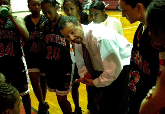 Brent Barker, seen here in 2006 with former assistant coach Nattlie McArthur, spent nearly 30 years as head coach of the South View girls' basketball team.