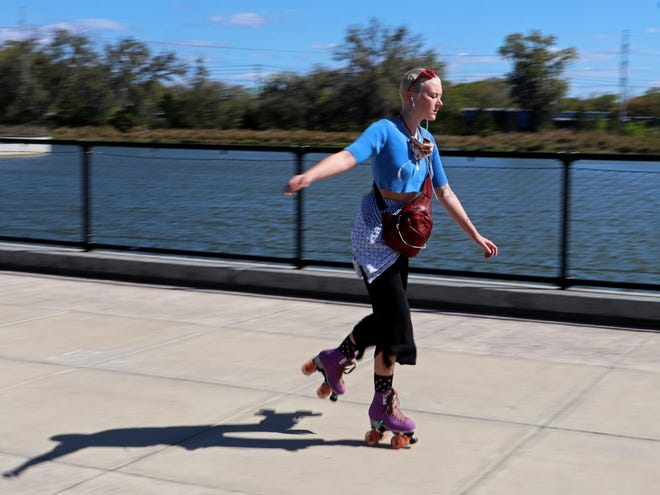 A woman roller skates at Depot Park in Gainesville.