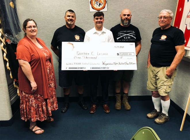 Gunner Lesher receives the Waynesboro Tigers Football Team Alumni's $1,000 Golden Tiger Scholarship.