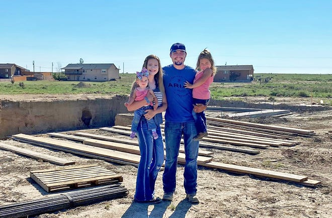 The Quint family (from left) Knightley, Kiaha, Kirby and Kyzleigh are struggling to build their new home on Cloudburst Lane in Pueblo West due to unexpected costs from road maintenance to lumber to utility hook ups.