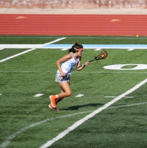 Pueblo West High School freshman, Morgan Avila, carries the ball down the field in a game against Denver South on Monday, June 7, 2021.