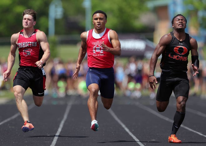 Hartley's Trey Saunders (center) finished second in the 100 meters in the Division II state meet June 5 at Pickerington North. He ran 11.02 seconds in the preliminary and 11.14 in the final, .05 behind Lisbon Beaver's Caleb White.