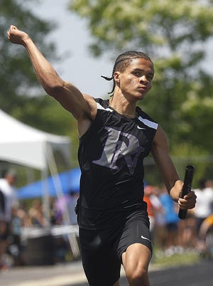 Steven McElroy celebrates North's first-place finish in the 800 relay in the Division I state meet June 5 at Hilliard Darby. McElroy anchored the winning 800 and 1,600 relays, helping the Panthers capture the team title. He also finished second in the 200 and third in the 400.