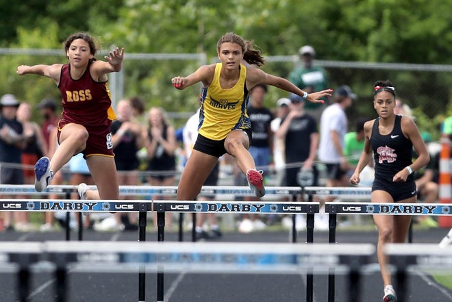 Olentangy sophomore Sydney Burrs (center) placed second in the 300 hurdles (44.17) and fifth in the 100 hurdles (15.1) in her first trip to the Division I state meet. She finished 0.99 of a second behind Gahanna's Camden Bentley in the 300 hurdles.