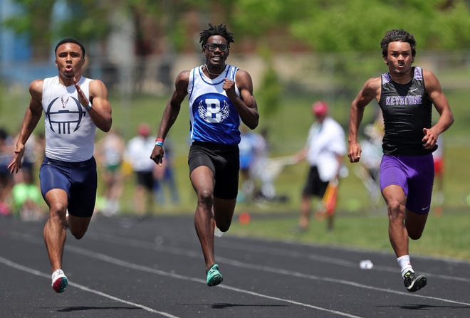 Bexley's Mason Louis (center) competes in the 100 meters in the Division II state meet June 5 at Pickerington North. Louis won the 400 (47.54 seconds), placed third in the 100 (11.16) and finished fifth in the 200 (22.46).
