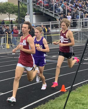 Columbus Academy's Luke Nester (right) runs with Watterson's Will Garey and Maumee's Eric Board in the 1,600 meters during the Division II regional meet May 29 at Lexington. Nester won the 1,600 at regional in 4:23.7 and then was seventh at state in 4:23.15.