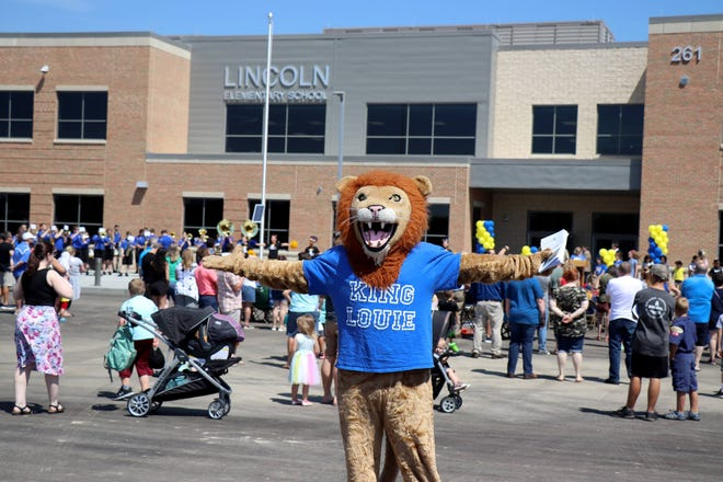 Gahanna Lincoln High School's King Louie mascot stands in front of the new Lincoln Elementary School, 261 Helmbright Drive, during a June 5 ribbon-cutting ceremony. The new school is the first that the Gahanna-Jefferson Public School District has opened in 26 years. All incoming Lincoln families were invited to a pizza party and building tours. The school is scheduled to open with about 700 students in August.