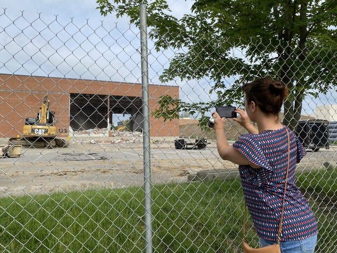 Upper Arlington High School art teacher Missy Haines films the beginning of demolition of the old high school June 8.