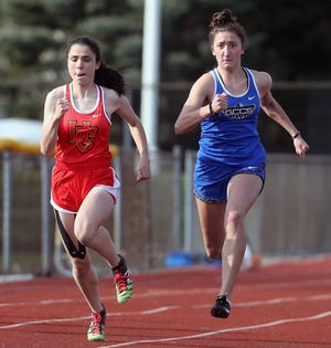 Grove City Christian's Bryanna Trout (right) competed in the Division III state meet in the 100 hurdles and 300 hurdles. Among the highlights of her season was winning the 300 hurdles in the regional meet.