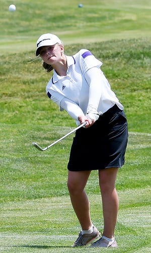 Watertown's Shelby Pearson pitches to the green Monday during the opening day fo the state Class AA high school girls golf tournament at Bakker Crossing Golf Course in Sioux Falls.