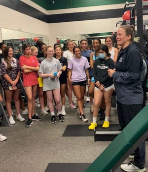 Waxahachie assistant volleyball coach Stephanie Poole talks to players at Waxahachie High School on Tuesday. Poole has accepted the head volleyball coach position at Allen.