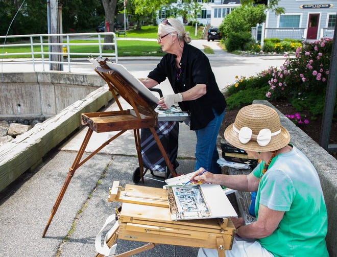 Candy Clark and Mary Beth LoPiccolo plein air on the Town Pier in 2014.