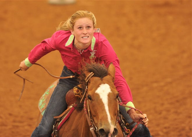 Hawley's Kaiden Roberts looks up at the big screen to see her time after her first go-round in pole bending at the Texas High School Rodeo Association State Finals on Tuesday at Taylor Telecom Arena.