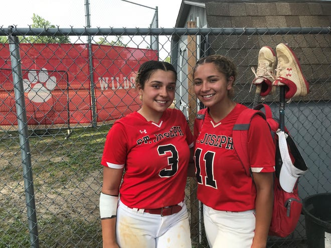 Xelynn Conde, left, and Davianna Jimenez each delivered key hits as St. Joseph opened its tournament play with an 8-0 win over Our Lady of Mercy on Monday.