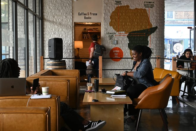 Francoise Kuzimierczuk and Daniel Hughes wrap up a meeting at Drip Coffee Lounge in Camp Washington on June 8, 2021. A fan of coffee, Kuzimierczuk said she is excited about a new coffee house to open near her home.