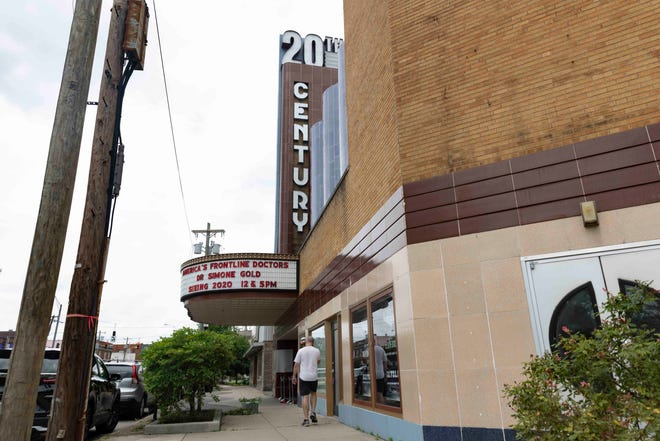 A man walks by The 20th Century Theater, Tuesday, June 8, 2021, in Oakley.