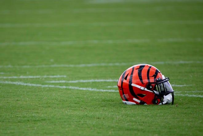 Cincinnati Bengals helmet sits on the practice field during Bengals organized team activities on Tuesday, June 8, 2021, in downtown Cincinnati.