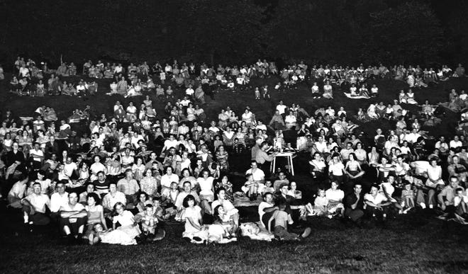 Movie-goers gather outdoors to watch a film in the Great Parks of Hamilton County several decades ago.