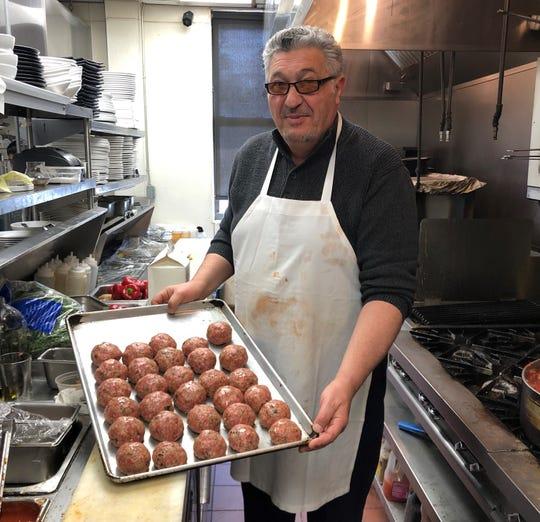 Salvatore Gramaglia, father of Joseph Gramaglia, with a batch of homemade meatballs.