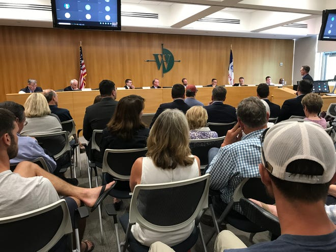 West Des Moines City Council members heard from residents Monday evening in support and against a proposed development at 304 5th Street in Valley Junction.