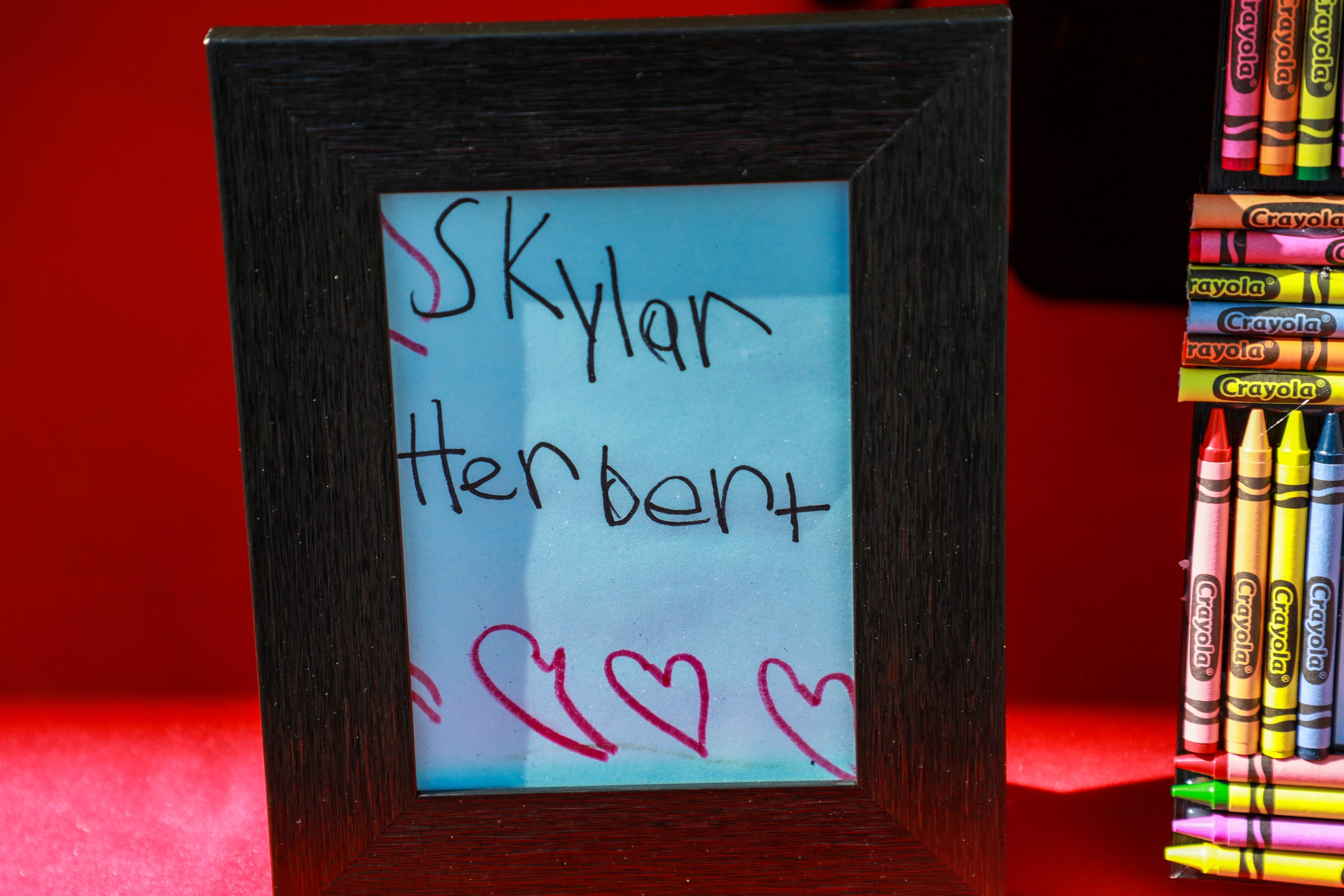 Skylar Herbert's, who was initially Michigan's youngest COVID-19 victim, elementary school, University Prep Academy - Mark Murray Campus plants a tree and some flowers in her memory on May 8, 2021. The school framed Skylar's artwork and gave it to her parents.
