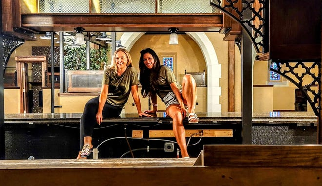 """Two friends, Sarah Palas (left) and Brandee Alexander, with 30 years of combined experience in the hospitality industry, are poised to open in August their new eatery """"The Cellar District,"""" in the old Trinity Lutheran Church building, 40 E. Division St. """